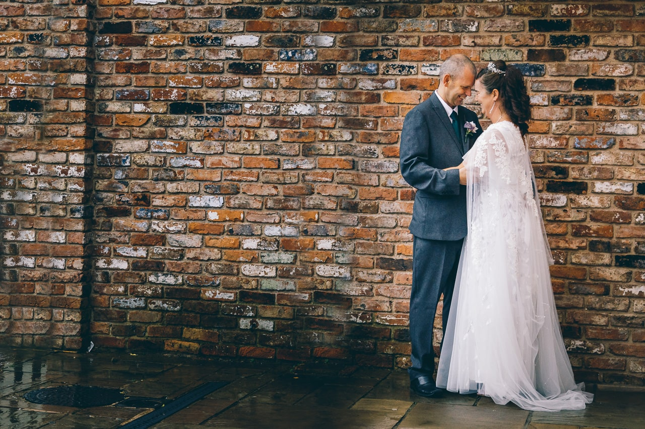 Tender moments between bride and groom