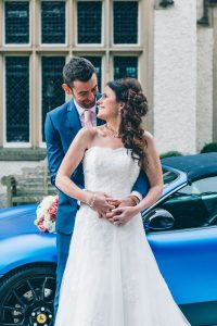 Bride and Groom with Ferrari at Mitton Hall
