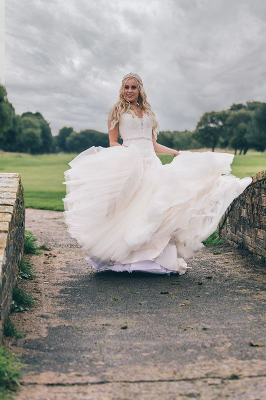 Bride having fun with her dress at Formby Hall