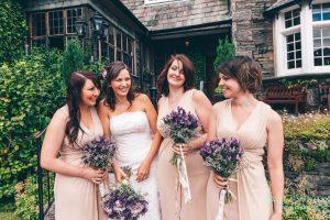 Bride and Bridesmaids having fun
