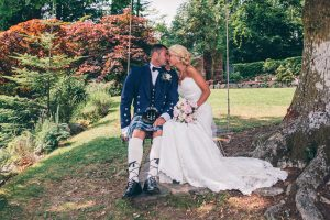 Bride and Groom on swing at Broadoaks Country House
