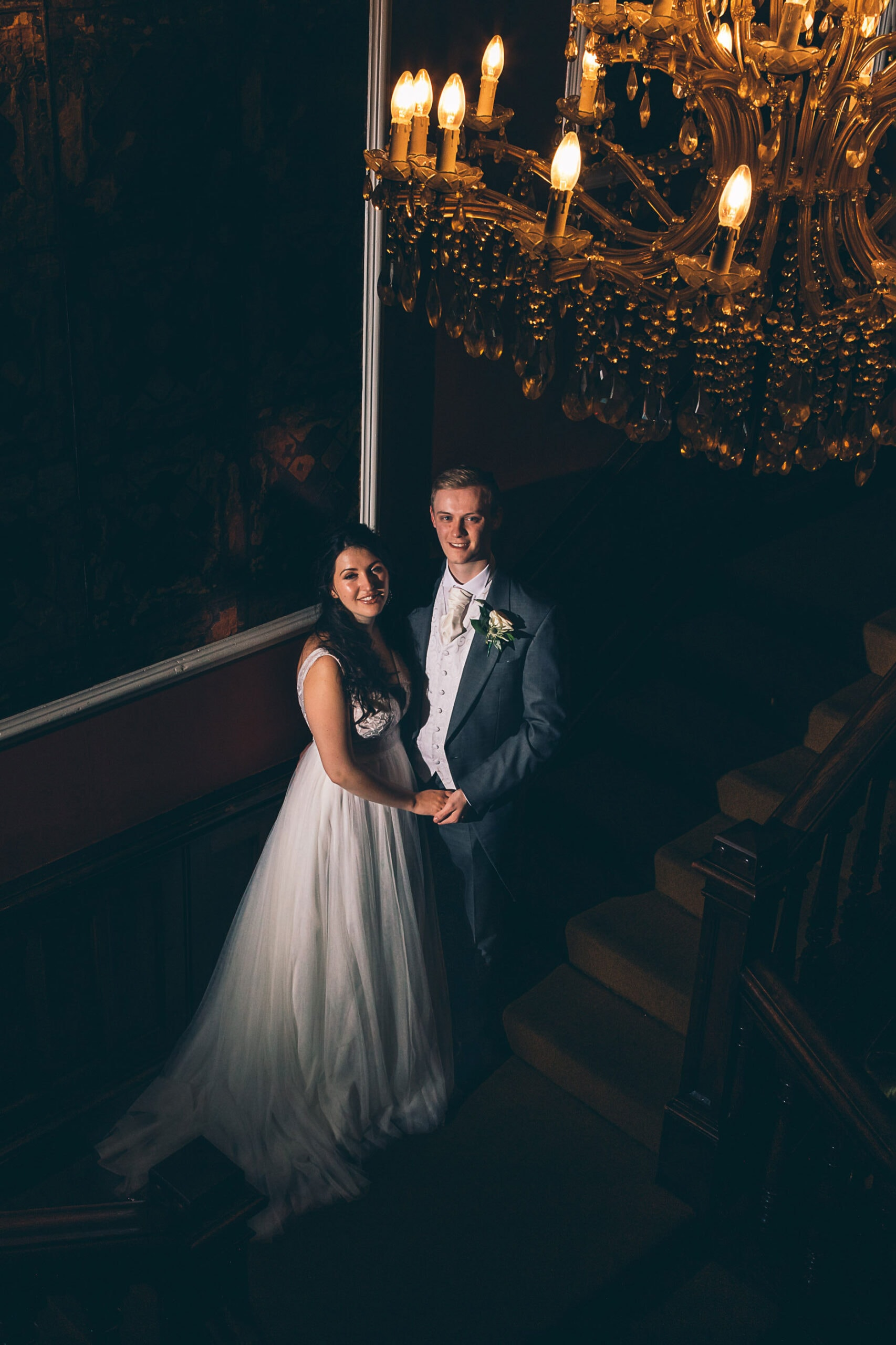 Bride and Groom on the stairs at Falcon Manor